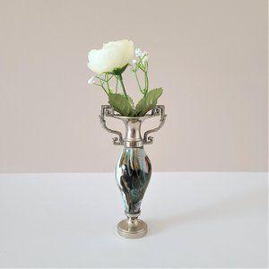 Stone and metal bud vase.